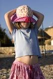 Little cute sad girl in panama in seashore. royalty free stock photography