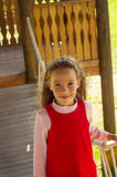 Little cute school girl portrait having fun and playing outdoor in summer day Stock Photos