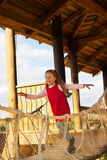 Little cute school girl in red dress having fun and playing outdoor in summer day Royalty Free Stock Photos