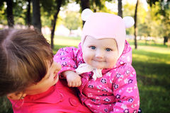Little cute sisters in autmn park Stock Photography