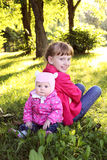 Little cute sisters in autmn park Stock Photos
