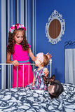 Little cute sisters and sphinx cat Royalty Free Stock Photo