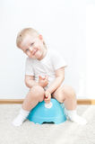 Little cute smiling boy on potty Royalty Free Stock Images