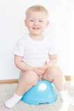 Little cute smiling boy on potty. Little cute smiling boy on blue potty. have toilet stock images