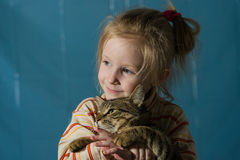 Little cute smiling girl hugging cat Royalty Free Stock Image