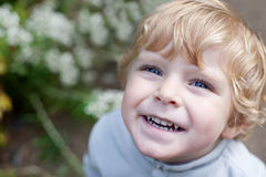 Little cute toddler boy with blond hairs Stock Photos