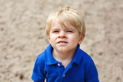 Little cute toddler boy with blond hairs Stock Image