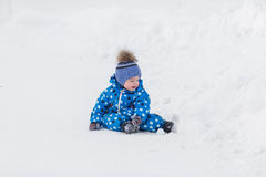 Little cute toddler boy walking outdoors on beautiful sunny winter day.  Royalty Free Stock Image