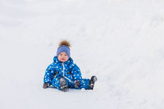 Little cute toddler boy walking outdoors on beautiful sunny winter day Royalty Free Stock Image