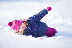 Little cute toddler girl outdoors on a sunny winter day. royalty free stock photography