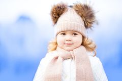 Little cute toddler girl outdoors on a sunny winter day. Stock Images