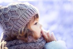 Little cute toddler girl outdoors on a sunny winter day. Stock Photography