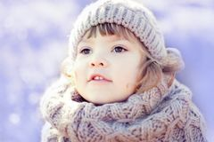 Little cute toddler girl outdoors on a sunny winter day. Royalty Free Stock Image