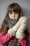 Little cute upset  girl with scarf Royalty Free Stock Images