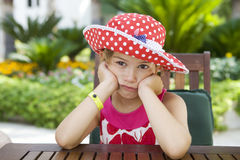 Little cute upset girl wearing Panama Stock Images