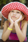 Little cute upset girl wearing Panama Stock Photos