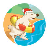 Little cute white bear wearing santa hat is running into the sea with rubber ring. Concept for travel agency. Royalty Free Stock Photos