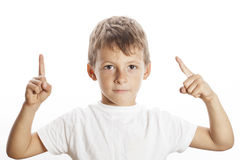 Little cute white boy pointing in studio isolated Royalty Free Stock Image