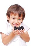 Little cute white kid with blackberry Stock Photo
