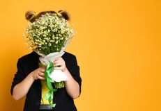 Little cute 5-year-old girl holds a large bouquet of daisies. Mother`s day concept stock photos