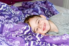 Boy  at bed. Little cutesmiling  boy  in pijamas at bed Royalty Free Stock Photos