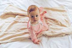 Little cutie in bed. Stock Images
