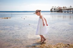 LIttle girl playing near water royalty free stock image
