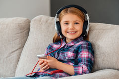 Little cutie loves music. Royalty Free Stock Photography