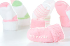 Little cutie socks. Little cutie sock with other baby socks in background Stock Photos