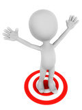 Got the target. A little 3d man standing on a red target circle, raising both hands in happiness that he has got his objective Royalty Free Stock Photo