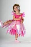 Little Dancer. Cute toddler girl dancing in a pink ballerina dress stock image