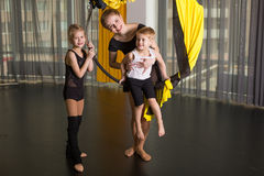 Little dancer in an acrobatic ring. In a dancing studio stock image