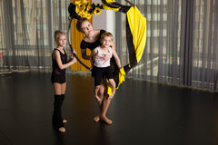 Little dancer in an acrobatic ring. In a dancing studio royalty free stock images