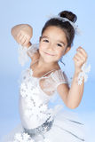 Little dancer, ballerina in white dress over blue Stock Photos