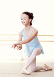 Little dancer doing exercises in ballet studio Royalty Free Stock Photos