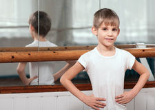 Dancer standing near barre Stock Images