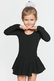Little dancing girl on the grey background Stock Photo