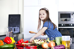 Little daughter cooking in the kitchen Royalty Free Stock Image