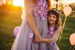 A little daughter cuddles up to her mother Stock Photography