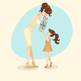 Little Daughter Gives Mom A Gift For Mother's Day. Royalty Free Stock Image