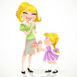 Little daughter gives mom a gift for Mothers Day Stock Images