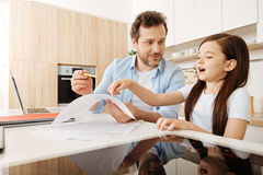 Little daughter helping his father to do his job Royalty Free Stock Photo