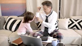 Little daughter helps father to button his shirt stock video