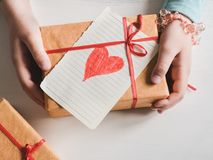Little daughter holding a gift stock image