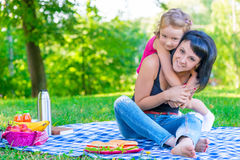 Little daughter hugging her mother Royalty Free Stock Images