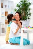 Little daughter hugs and kisses mom. Happy family and love. Mother`s day.  royalty free stock photography