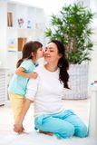 Little daughter hugs and kisses mom. Happy family and love. Mother`s day.  royalty free stock photos