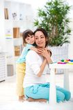 Little daughter hugs mom. Happy family and love. Mother`s day.  royalty free stock photo