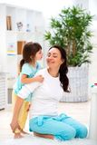 Little daughter hugs mom. Happy family and love. Mother`s day.  stock photography