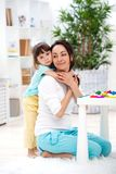 Little daughter hugs mom. Happy family and love. Mother`s day.  stock photo